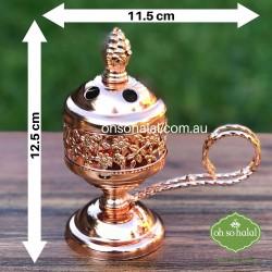 Metal incense/bakhoor burner in rose gold colour with carry handle